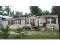 This is a nice double wide home on 4.4 acre corner lot