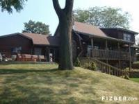RATE REDUCED! EXQUISITE LODGE HOME! 3 FLOORS OF LAKE