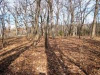 Beautiful wooded 1.79 acre (net of r.o.w.) corner lot