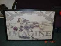 "I have a 36x24 inch textured print that says ""Imagine"""