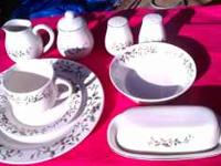 This set has 8 plates, 8 saucers, 8 cups, 8 bowls, a