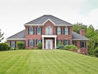 Custom built brick home with walk-out LL. Stunning