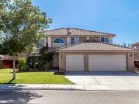 This sprawling East Palmdale two-story home is located