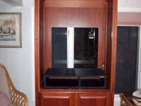tv wall unit/entertainment center can hold up to about