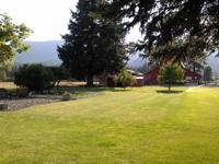 Beautiful landscaped small farm with 8+acres in