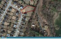 We are offering our one-half acre land lot in an