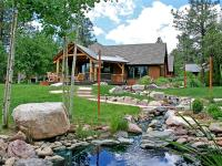 This 5,010 SF house sits on 6.88 acres and has gorgeous