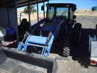2010 New Holland T2410 fully enclosed Boomer Utility