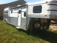 2003 Elite four horse trailer, drop windows head and