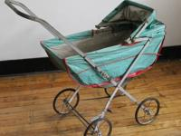 A vintage doll carriage by Welsh, manufacturers of doll