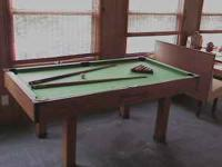 Like new pool table and all access. 39 x 72 size ,made