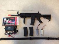 RIFLE:      A&K Airsoft M4 Electirc Rifle. The gun is