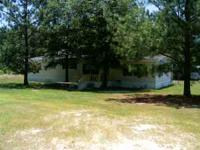 3/2 Double Wide mobile home on 2.56 acres for sale.