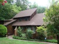 Special, distinctive 3 level cedar home with full-size