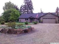 Beautifully cared for newer home on 8.35 acres.