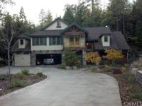 Gorgeous Custom home on Acreage at Bass Lake that also