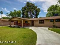 Situated on a corner lot, this elegantly remodeled