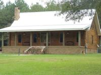 Immaculate 3bd, 2.5ba log home with open floor plan,