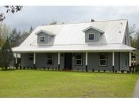 IMPECCABLY MAINTAINED,GATED 10 ACRE HOME OFFERING A 48