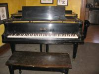 BABY GRAND PIANO GOOD CONDITION. BLACK MOVING AND CAN