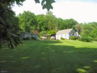 Welcome to a well kept Cape Cod Home on 7+ acres -