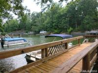 Big wooded lot & your own boat dock in Gated Country