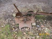 This antique crosscut saw is PTO driven and mounts on a