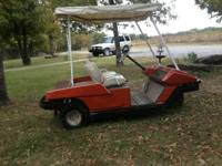 3 wheel, 36 volt golf cart. Charger and trailer