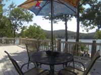 Stunning Lakefront house in Popular Proctor Cove at the