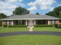 Beautiful 3/2 brick home with 3 acres just north of the