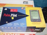 Item description: Palm Pilot comes with everything,