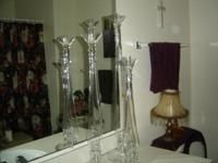 I am selling 3 very pretty glass candle holders they