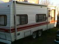 1986 23' Fleetwood Prowler Camper with awning in