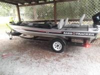 ?1987 17' Bass Tracker w/ 70 hp Evinrude motor. New