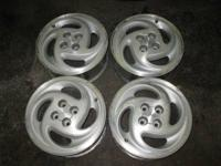 THIS IS A USED SET OF FOUR MATCHING ALUMINUM SATURN