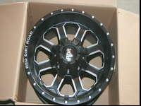 A SET OF 4 RIMS NEW IN BOX 17X9 8X6.5 0 OFFSET BLACK