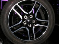 4 18 x 8 mustang wheels with 235-50-18 goodyear tires