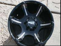 A SET OF 4 18X9 MOTO METAL BLACK AND MACHINED WHEELS