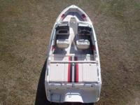 THIS IS A 1990 DONZI BOWRIDER 19'. IT HAS A 4.3 LITER