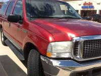 A 2003 Emerald Red ford excursion very good condition