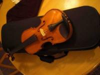 A beautiful flamed hand made 4/4 violin Carved out of