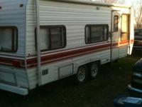 1986 23' fleetwood prowler camper trailer with awning