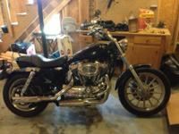 I have a totally rebuilt 2005 HD Sportster 1200 black,