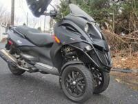 The Piaggio MP3 500, with aggressive styling and