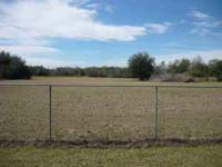FOR SALE 4.9 Acres Zoned Commercial partially fenced on