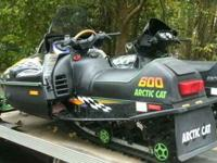 2 ARCTIC CAT SNOWMOBILES AND TRAILER Note; These sleds