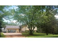 5+ acres with lots of trees. Walkout lower level. This