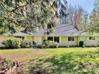 Wonderful location on quiet street with over 4 acres of