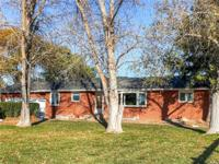 Beautiful recently updated solid brick home with