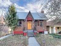Fabulous Avenues Tudor! Charm abounds with wood floors,